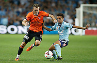 Brisbane Roar Besart Berisha (L) and Sydney FC Hagi Gligor during their A-League match in Sydney, March 14, 2014. Photo by Daniel Munoz/VIEWPRESS EDITORIAL USE ONLY