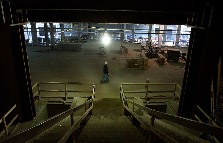 A worker walks through the construction site of the Capitol Visitor Center