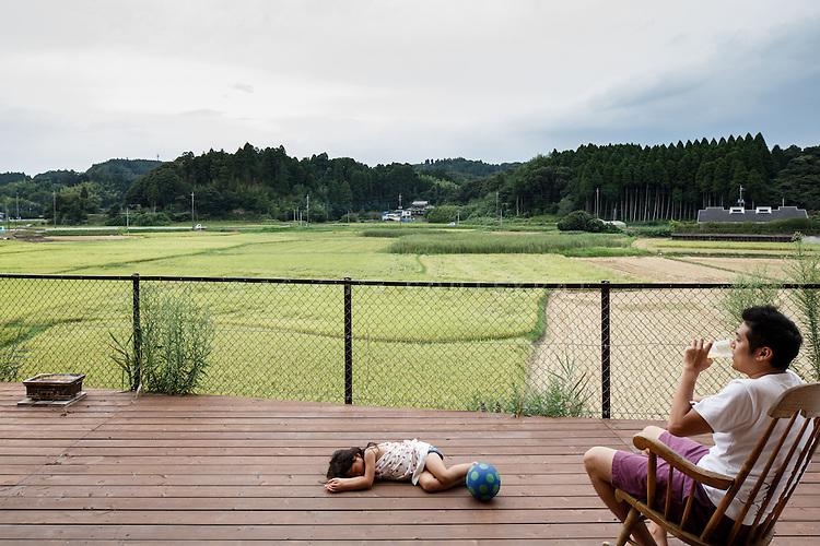Chiba, August 24 2013 - Owner and kids on the terrace of Kiritoshi house by Japanese architect Daisuke Sugawara.