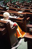 WARSAW, POLAND, December 25, 2016:  Member of Civic Platform is sitting in the plenary hall covered in blanket because the heating has been switched off.<br /> Polish opposition MP's from Civic Platform and Modern parties have been occupying the Sejm, Polish parliament since December 16 in protest to the government's curbing of free press access to the parliament.<br /> (Photo by Polish opposition MP for Piotr Malecki / Napo Images)***WARSZAWA, 25/12/2016:<br /> Poslanka opozycji parlamentarnej siedzi owinieta w koc w sali plenarnej podczas okupacji Sejmu przez opozycje, podczas okupacji Sejmu przez opozycje. Jest zimno, wylaczono ogrzewanie.<br /> Fot: Posel opozycji dla Piotra Maleckiego / Napo / Forum<br /> ****<br /> ###ZDJECIE MOZE BYC UZYTE W KONTEKSCIE NIEOBRAZAJACYM OSOB PRZEDSTAWIONYCH NA FOTOGRAFII### ###  ###ZDJECIE MOZE BYC UZYTE W KONTEKSCIE NIEOBRAZAJACYM OSOB PRZEDSTAWIONYCH NA FOTOGRAFII###
