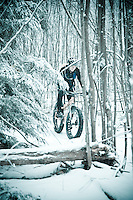 Fat bike snow bike riding on snowy singletrack in Marquette Michigan.