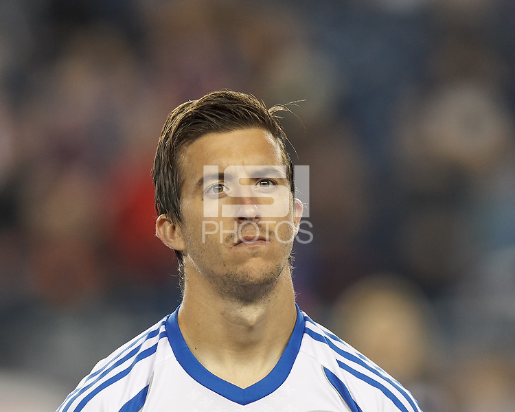 Montreal Impact defender Jeb Brovsky (5). In a Major League Soccer (MLS) match, Montreal Impact (white/blue) defeated the New England Revolution (dark blue), 4-2, at Gillette Stadium on September 8, 2013.
