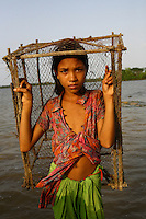 A young girl wades through the floodwaters. Thousands of people were displaced in Shyamnagar Upazila, Satkhira district after Cyclone Aila struck Bangladesh on 25/05/2009, triggering tidal surges and floods..