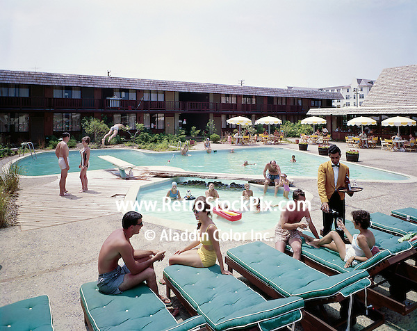 Couple ordering drinks poolside from the waiter of the Thunderbird Motel in North Wildwood, New Jersey.