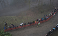 Gioele Bertolini (ITA/U23) running loney (&amp; last) up a hill after crashing at the start of the Men's U23 race<br /> <br /> UCI Cyclocross World Cup Namur/Belgium 2016