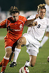 9 November 2005: Clemson's Havrid Usry (6) shoulders Virginia's Adam Cristman (9) off the ball. Clemson University defeated the University of Virginia 4-1 at SAS Stadium in Cary, North Carolina in a quarterfinal of the 2005 ACC Men's Soccer Championship.