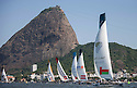 7th December, 2012. Rio de Janeiro, Brazil..Extreme Sailing Series 2012, Act 8..Images of Oman Air, skippered by Morgan Larson (USA), with tactician Will Howden (GBR), mainsail trim Charlie Ogletree (USA), headsail trim Andy Maloney (NZL) and bowman Nasser Al Mashari (OMA)...Credit: Lloyd Images.