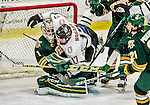 17 October 2015: University of Nebraska Omaha Maverick Forward Luke Nogard, a Sophomore from Ancaster, Ontario, collides with University of Vermont Catamount Goaltender Mike Santaguida, a Junior from Mississauga, Ontario during the third period at Gutterson Fieldhouse in Burlington, Vermont. The Mavericks defeated the Catamounts 3-1 in the second game of their weekend series. Mandatory Credit: Ed Wolfstein Photo *** RAW (NEF) Image File Available ***