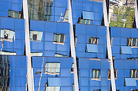 Reflections in the futuristic glass-fronted Silken Gran Hotel at Bilbao, Basque country, Spain