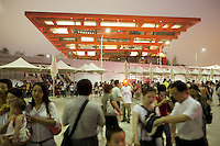 China. Shanghai. World Expo. Expo 2010 Shanghai China. View on the China Pavilion at night. Chinese tourists take pictures and enjoy the sunset. 27.06.10 &copy; 2010 Didier Ruef