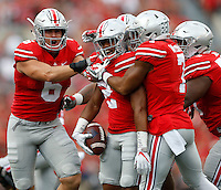 Ohio State Buckeyes defensive end Sam Hubbard (6) celebrates after Ohio State Buckeyes cornerback Marshon Lattimore (2) intercepted a pass in the first play of the game during  an NCAA football game between the Ohio State Buckeyes and the Tulsa Golden Hurricane at Ohio Stadium on Saturday, September 10, 2016. (Columbus Dispatch photo by Fred Squillante)