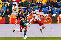Landon Donovan (10) of the Los Angeles Galaxy and Kosuke Kimura (27) of the New York Red Bulls. The New York Red Bulls defeated the Los Angeles Galaxy 1-0 during a Major League Soccer (MLS) match at Red Bull Arena in Harrison, NJ, on May 19, 2013.