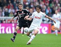 FUSSBALL   1. BUNDESLIGA  SAISON 2011/2012   34. Spieltag 1. FC Koeln - FC Bayern Muenchen        05.05.2012 Thomas Mueller (li.FC Bayern Muenchen) gegen Pedro Geromel (1. FC Koeln)