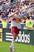 Kenny Cooper (33) of the New York Red Bulls celebrates scoring the game winning goal. The New York Red Bulls defeated the Philadelphia Union  3-2 during a Major League Soccer (MLS) match at PPL Park in Chester, PA, on May 13, 2012.