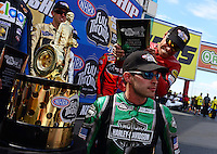 Sept. 14, 2012; Concord, NC, USA: NHRA pro stock motorcycle rider Hector Arana Jr (standing) jokingly pretends to hit Andrew Hines on the head during qualifying for the O'Reilly Auto Parts Nationals at zMax Dragway. Mandatory Credit: Mark J. Rebilas-