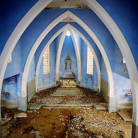 The decaying, graffiti covered, Mussulo church on the island of Cazanga. The church was built by the Portuguese who would convert slaves to Christianity there prior to their transportation to the New World.