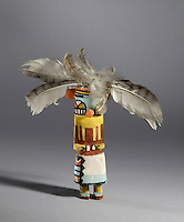 Tootsa katsina, by Viets Lomahaftewa, Hopi Shung-opavi artist, made 1952 from wood, paint and feathers, bought through the Native Arts Acquisition Fund, in the Denver Art Museum, Denver, Colorado, USA. Hopi katsina figures or kachina dolls are figures carved, typically from cottonwood root, by Hopi people to teach girls about katsinas or katsinam, the immortal beings that bring rain and act as messengers between humans and the spirits. The Tootsa katsina is a hummingbird katsina who sings prayers for moisture and dances quickly to encourage rain. The Hopi tribe live in North East Arizona and have been making these katsina figures since the 19th century. Picture by Manuel Cohen