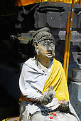 Close-up of a dressed, stone, buddhist statue at Rambut Siwi, Bali, Indonesia.