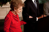 Washington, DC - June 2, 2009 -- Former First Lady Nancy Reagan embraces President Barack Obama's arm at the podium as he announces and signs the Ronald Reagan Centennial Commission Act in the Diplomatic Room of the White House, June 2, 2009.&nbsp;<br /> Mandatory Credit: Pete Souza - White House via CNP