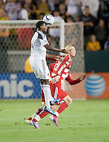 CARSON, CA – NOVEMBER 14: LA Galaxy forward Edson Buddle (14) and FC Dallas midfielder Brek Shea (20) during the Western Conference Final soccer match at the Home Depot Center, November 14, 2010 in Carson, California. Final score LA Galaxy 0, Dallas FC 3.