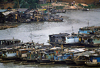 Houseboats and cargo boats on the Pearl River at Canton, China in the 1980s