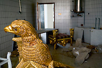 """Baghdad, Iraq, April 13, 2003.Saddam's gold plated eagle-shaped throne, inside the looted """"Triumphant Leader Museum"""", entirely dedicated to the glory of Saddam Hussein, set on fire today."""