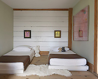 In the children's bedroom the paintings are by Hunt Slonem and the beds were custom made by Stilin