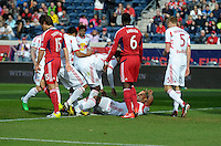 New York defender Jamison Olave (4, on ground) is congratulated by his teammates after scoring a goal.  The Chicago Fire defeated the New York Red Bulls 3-1 at Toyota Park in Bridgeview, IL on April 7, 2013.