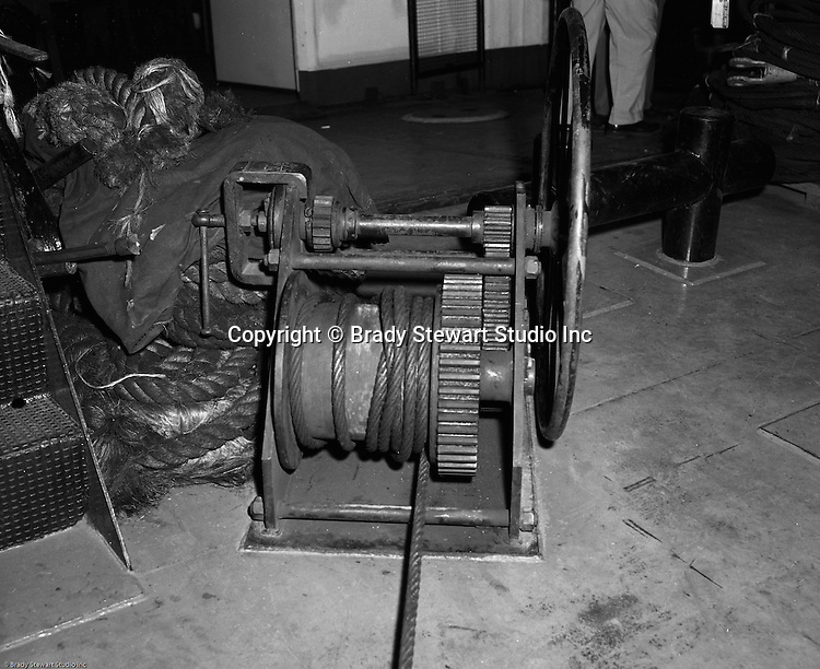Pittsburgh PA:  Public Relations assignment for WW Patterson Company; a manufacturer of Towboat and Barge Winches - 1955. View of the new Patterson Winch on the new Lady Jane towboat owned by Campbell Barge Lines.  This was part of a tour during a marine industry meeting introducing the new Dravo towboat that was purchased by Campbell Barge Lines for use in a contract for the Army Corp of Engineers.  The new towboat had all the new bells and whistles including state-of-the-art radar.