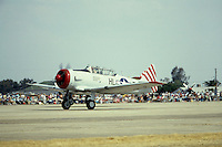Photo of a North American WW2 AT-6 Fighter Trainer Airplane going down the Runway