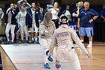 12 February 2017: UNC's Meredith Bozentka (left) and Northwestern's Alisha Gomez-Shah (right) during Saber. The University of North Carolina Tar Heels played the Northwestern University Wildcats at Card Gym in Durham, North Carolina in a 2017 College Women's Fencing match. UNC won the dual match 15-12 overall, 5-4 Foil, 5-4 Epee, and 5-4 Saber.