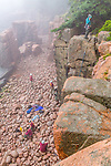 Rock climbers at  the Shore Path in Acadia National Park, Maine, USA