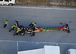 Jan. 21, 2012; Jupiter, FL, USA: Aerial view of crew members pushing the car of NHRA top fuel dragster driver Terry McMillen during testing at the PRO Winter Warmup at Palm Beach International Raceway. Mandatory Credit: Mark J. Rebilas-