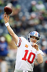 New York Giants quarterback Eli Manning (10) warms up before their game against the Seattle Seahawks at CenturyLink Field in Seattle, Washington on November 9, 2014.    ©2014. Jim Bryant Photo. All rights Reserved.