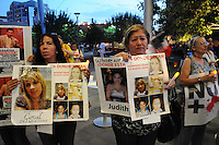 "Phoenix, Arizona - Dora Elvia Aguirre (right) holds a photograph of her daughter Judith Ceja Aguirre and five friends who went missing in 2011.  Members of the ""Caravan for Peace with Justice and Dignity"" held a rally and vigil at the Civic Space Park in Downtown Phoenix. All six young women disappeared in the state of Nuevo Leon, in Mexico. Elvia Aguirre joined the caravan in hopes to find Judith as she creates awareness about this missing persons case.  The ""Caravan for Peace with Justice and Dignity"" stopped in Phoenix on Wednesday, August 15, 2012 as it travels across the United States as a way to create awareness in the United States about the failed drug war in Mexico that has left more than 70,000 dead. The caravan is led by Mexican poet, essayist, novelist, and journalist Javier Sicilia, whose son Juan Francisco Sicilia Ortega son was brutally murdered along with six other students in Morelos, Mexico by members of a drug cartel on March 28, 2011. In response, Sicilia created the Movement for Peace with Justice and Dignity --popularly known as ¡Ya Estamos Hasta la Madre! or We Have Had It!-- calling for an end the drug cartels bloodshed. Photo by Eduardo Barraza © 2012"