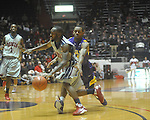 "Ole Miss guard Chris Warren (12)  vs. Louisiana State's Daron Populist (25) at the C.M. ""Tad"" Smith Coliseum in Oxford, Miss. on Wednesday, February 9, 2011. Ole Miss won 66-60 and is now 4-5 in the Southeastern Conference."