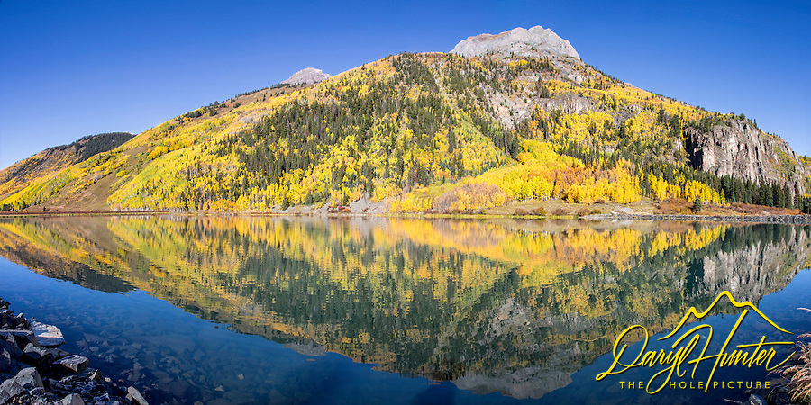 Hayden Mountain reflection in the still waters of Crystal Lake. This gem can be found on Red Mountain Pass south of Ouray Colorado.<br /> <br /> This panorama is a 150 megabyte file and can be printed at 170dpi at 60 inches wide at a 2X1 crop.