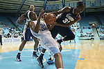 14 November 2012: North Carolina's Xylina McDaniel (34) and Georgetown's Brittany Horne (33) challenge for a rebound. The University of North Carolina Tar Heels played the Georgetown University Hoyas at Carmichael Arena in Chapel Hill, North Carolina in an NCAA Division I Women's Basketball game, and a semifinal in the Preseason WNIT. UNC won the game 63-48.