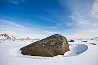 Large boulder in snow covered winter landscape, Near Stamsund, Vestvågøy, Lofoten islands, Norway