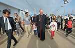 Cardinal Timothy Dolan, the archbishop of New York and chair of the Catholic Near East Welfare Association, walks through a camp for displaced Iraqis in Dawodiya, Iraq, on April 10, 2016. <br /> <br /> Cardinal Dolan came to northern Iraq with Bishop William Murphy of Rockville Centre and other church leaders to visit with Christians and others affected by ISIS. Murphy is also a member of CNEWA's beard.<br /> <br /> CNEWA is a papal agency providing humanitarian and pastoral support to the church and people in the region.