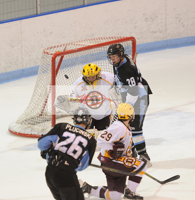 Chugiak's Zachary Plucinski (26) scores over the shoulder of Dimond goalie Chirs Gardeline during the Mustangs' 6-2 Cook Inlet Conference championship win at Ben Boeke Arena Saturday, February 6, 2016.  Photo for the Star by Michael DInneen