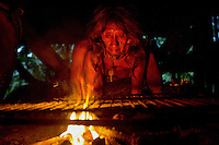 Mementoke Coba, a Waorani  (Huaroni) woman, starts a fire to cook bushmeat in the early morning.