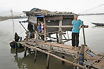 Nguyen Viet Xinh lost his arm to a landmine left over from the U.S. war in Vietnam. Today he fishes in Bao Ninh, Vietnam, where he lives in a house over the river with his wife Nguyen Thi Ba...