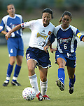 Zhang Ouying (7) tries to hold off Tiffany Roberts (5) at SAS Stadium in Cary, North Carolina on 7/19/03 during a game between the Carolina Courage and San Diego Spirit. Carolina won the game 1-0