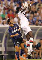 Emmanuel Adebayor #25 of Inter Milan heads the ball away from Christian Chivu #26 of Manchester City during an international friendly match on July 31 2010 at M&T Bank Stadium in Baltimore, Maryland. Milan won 3-0.