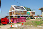 """Make It Right NOLA is Brad Pitt's green project to rebuild the lower 9th ward in New Orleans pictured Dec. 29, 2009 are the rebuilt """"green homes"""". The installation of all the pink houses is to represent the 13 different types of green housing offered by Make It Right and they are illuminated at night by solar panels and solar candels."""
