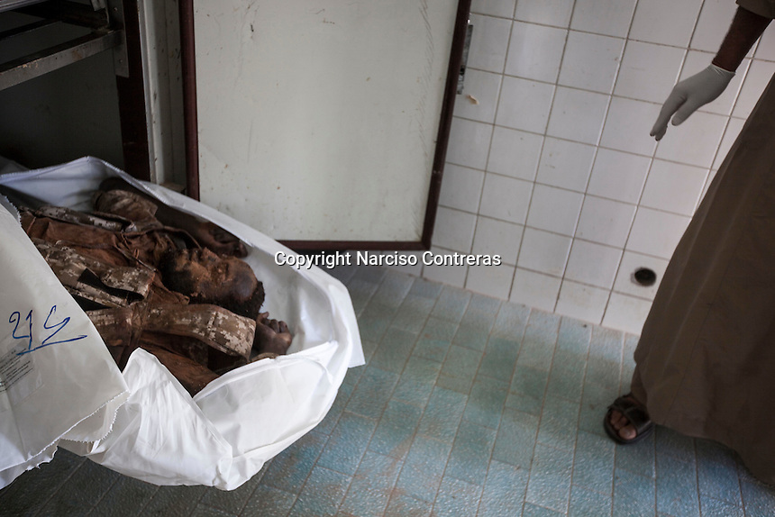 Sunday 22, May 2016: The body of a dead ISIL fighter is shown at the morgue of Misrata, Libya.