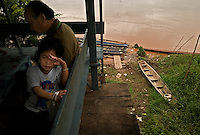 """Vientiane, Laos, August 11, 2007.Along the mighty Mekong, backbone of Indochina, 4880km long. On the other side, Thailand. Poupee (""""Doll"""") is 5 years old."""