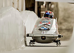 8 January 2016: Donghyun Kim, piloting his 2-man bobsled for South Korea, enters the Chicane straightaway on his first run, ending the day with a combined 2-run time of 1:51.90 and earning a 15th place finish at the BMW IBSF World Cup Championships at the Olympic Sports Track in Lake Placid, New York, USA. Mandatory Credit: Ed Wolfstein Photo *** RAW (NEF) Image File Available ***