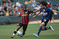 Shaun Wright-Phillips (left) dribbles the ball against Joaquin Martinez (right). Manchester City defeated Club America 2-0 in the Herbalife World Football Challenge 2011 at AT&T Park in San Francisco, California on July 16th, 2011.